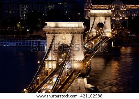 Night traffic of cars on Secheni Bridge through Danube in Budapest - stock photo