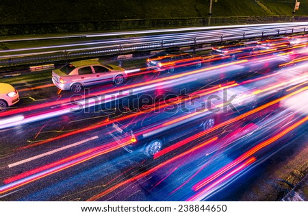 Night traffic with blurred traces from cars - stock photo