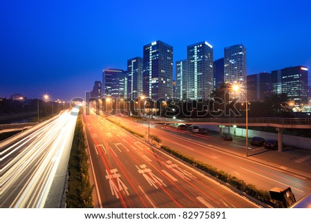 night traffic with modern cityscape in beijing,China - stock photo
