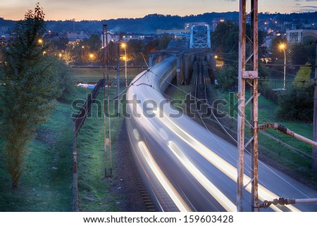 Night train in motion - stock photo