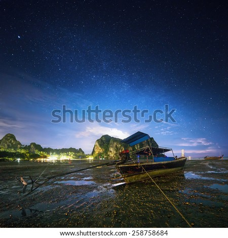 Night tropical landscape with beautiful blue sky and stars. Thailand - stock photo