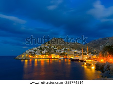 night view after a sunset of the port of Hydra island in Greece - stock photo