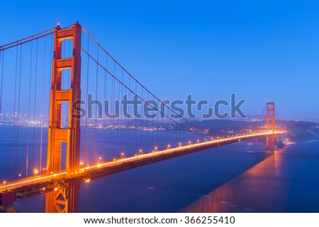 Night view at illuminated Golden Gate Bridge which spans Golden Gate strait at San Francisco Bay. California, USA - stock photo