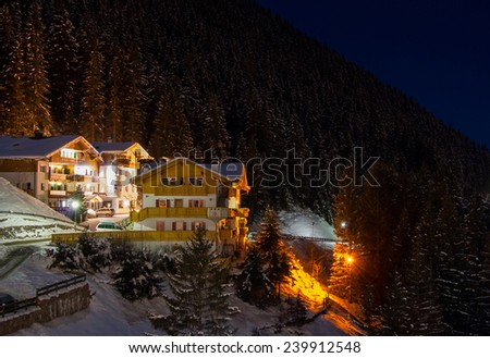 Night view at the ski resort at the mountain slopes (Dolomites, Italy) - stock photo