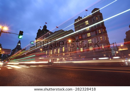 Night view car light trails of ancient century European-style buildings on the Bund in Shanghai - stock photo