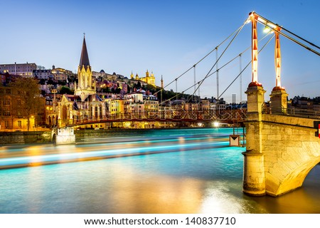 night view from St Georges footbridge in Lyon city with Fourviere cathedral, France - stock photo