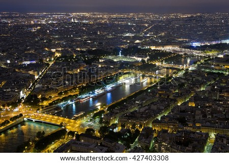 Night view from the heights of Paris and the Seine River - stock photo
