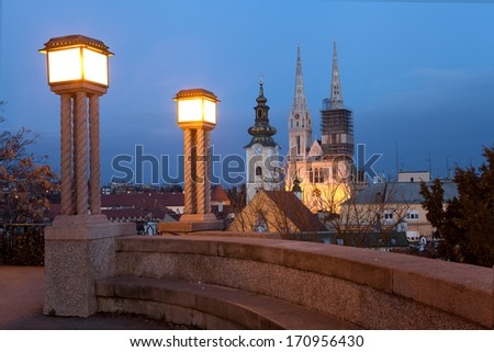Night view from the Strossmayer Promenade towards Kaptol, the cathedral, St Mary's Church and the rooftops of Dolac Market. - stock photo