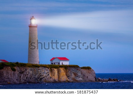 Night view of a lighthouse with a ray of light in Canada