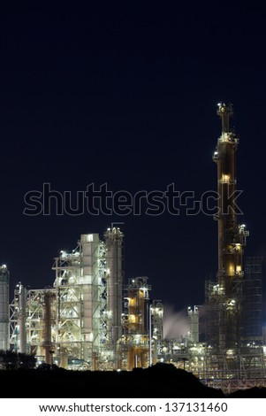 Night View of an Oil Refinery Plant. Vertical shot - stock photo
