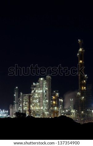 Night View of an Oil Refinery Plant. Vertical shot