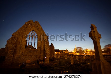 Night view of Athenry Dominican Friary, dedicated to Saints Peter and Paul,found at 1241, with cemitary. - stock photo