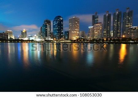 Night view of Bangkok from lake Ratchada - stock photo