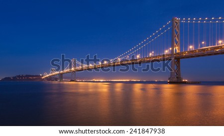 Night view of Bay Bridge between San Francisco and Treasure Island. - stock photo