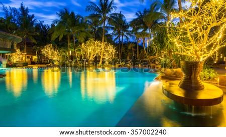 night view of beautiful swimming pool in tropical resort , Phuket, Thailand - stock photo