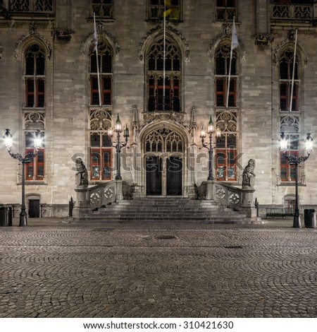 Night view of Bruges Belfort main facade, Grote Markt square, old town of  Belgium - stock photo