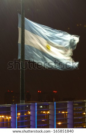 night view of buenos aires in the rain and the Argentine flag - stock photo