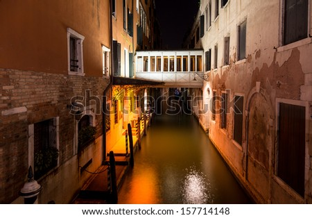 night view of canal and palaces in Venice, Italy