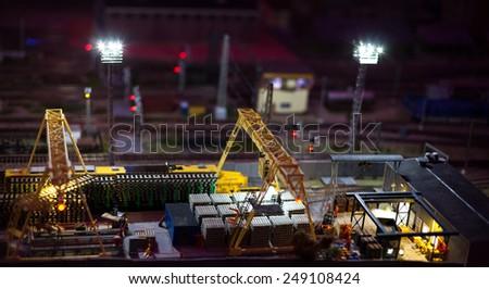 night view of cargo railway station model toy - stock photo