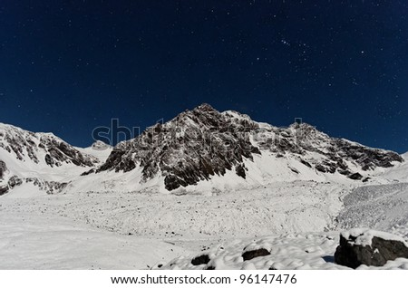 Night view of Cathedral mountain from Plaza de Mulas base camp, just after a snow storm. Aconcagua Provincial Park, Mendoza, Argentina, South America. - stock photo