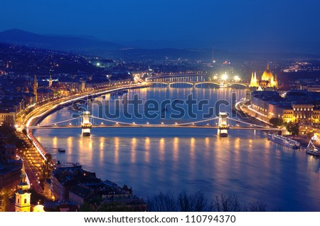 night view of Chain Bridge on the Danube river and the city of Budapest - stock photo