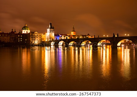Night view of Charles bridge and Church of St. Francis. Prague, Czech Republic