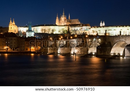 night view of Charles bridge, Saint Vitus cathedral and president palace in Prague