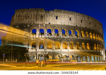 Night view of Colosseum with traffic lights in Rome, Italy