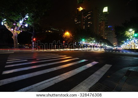Night view of Crosswalk and pedestrian at modern city zebra crossing street. Blur abstract. - stock photo
