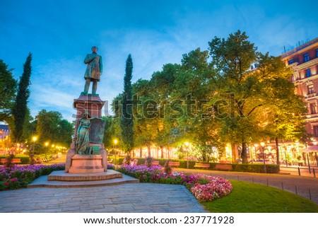 Night View Of Esplanade Park. Statue Of Johan Ludvig Runeberg in Helsinki, Finland - stock photo