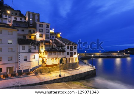 Night view of fisherman village in northern Spain (Cudillero,Asturias) - stock photo