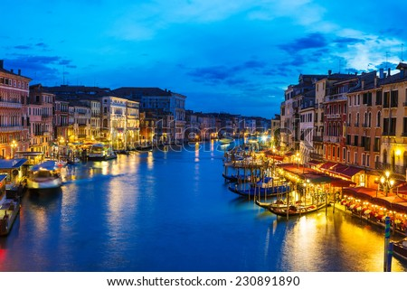 Night view of Grand Canal with gondolas in Venice. Italy - stock photo