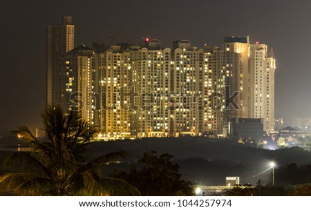night view of high rise buildings.