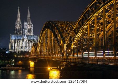 Night view of Hohenzollern Bridge and the cathedral in Cologne, Germany - stock photo