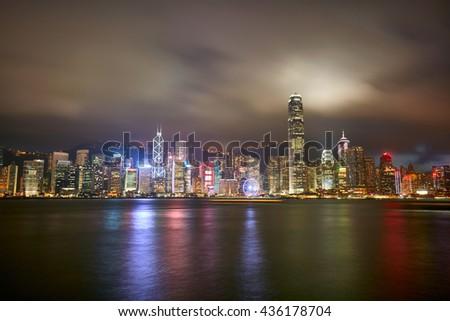 Night view of Hong Kong Island from Kowloon - stock photo