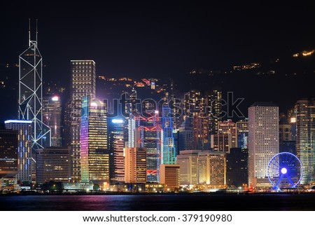 Night view of Hong Kong Island skyline from Kowloon side. Skyscrapers in downtown of Hong Kong. Hong Kong is a global financial center and a popular tourist destination of Asia. - stock photo