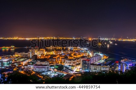 night view of illuminated gibraltar and algeciras bay - stock photo
