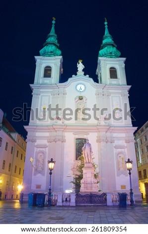 night view of illuminated saint maria bernabiten church in wien. - stock photo