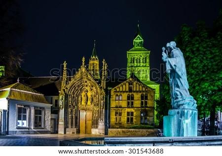 night view of illuminated  sint servaas basilica in dutch maastricht. - stock photo