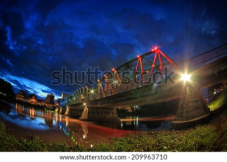 Night View of iron Bridge in Chiang mai Thailand - stock photo