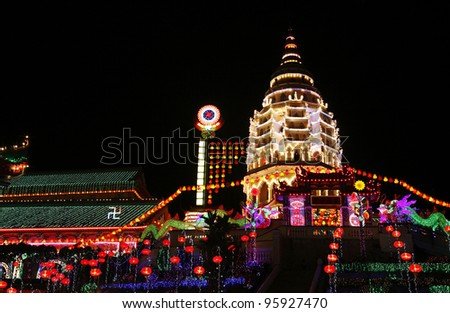 Night view of Kek Lok Si buddhist complex pagoda illuminated with colorful annual decorative festival lightings for Chinese New Year, in Air Itam, Penang, Malaysia.