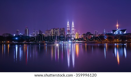 Night view of Kuala Lumpur city with stunning reflection in water        - stock photo