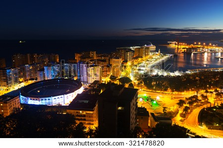 Night view of  Malaga with Port and Placa de Torros from castle.  Andalusia, Spain