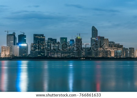night view of modern city waterfront downtown skyline,China.