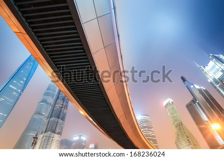 night view of modern metropolis in shanghai,pedestrian bridge through lujiazui financial center,China  - stock photo