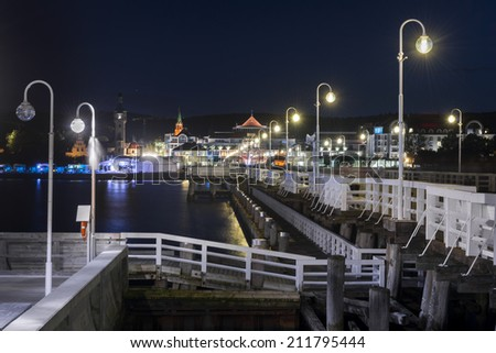 Night view of Molo pier and Sopot city at the Baltic sea in Poland