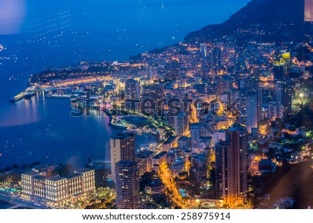 Night view of Monaco from mountain - stock photo
