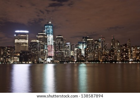 Night view of New York's Lower Manhattan Skyline (World Trade Center) featuring Freedom Tower from across the Hudson River.
