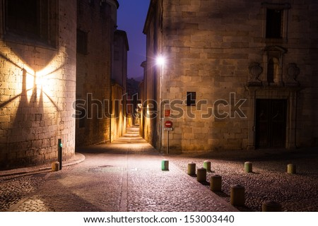 night view of old narrow street of european city.  Girona, Spain - stock photo