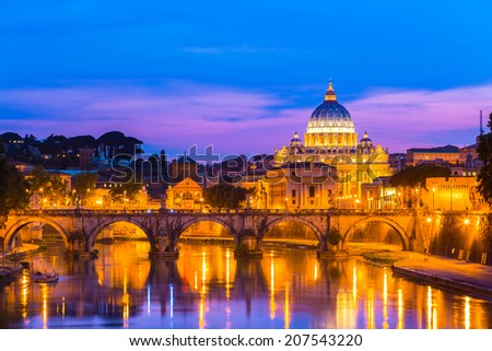 Night view of old roman Bridge of Hadrian and St. Peter's cathedral in Vatican City Rome Italy. - stock photo